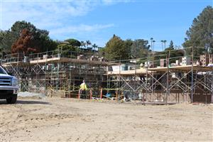 Two-story classroom building masonry underway