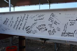 Steel beam with signatures
