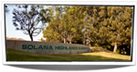 Solana Highlands Concrete Sign at Front of School, grass and trees in the background