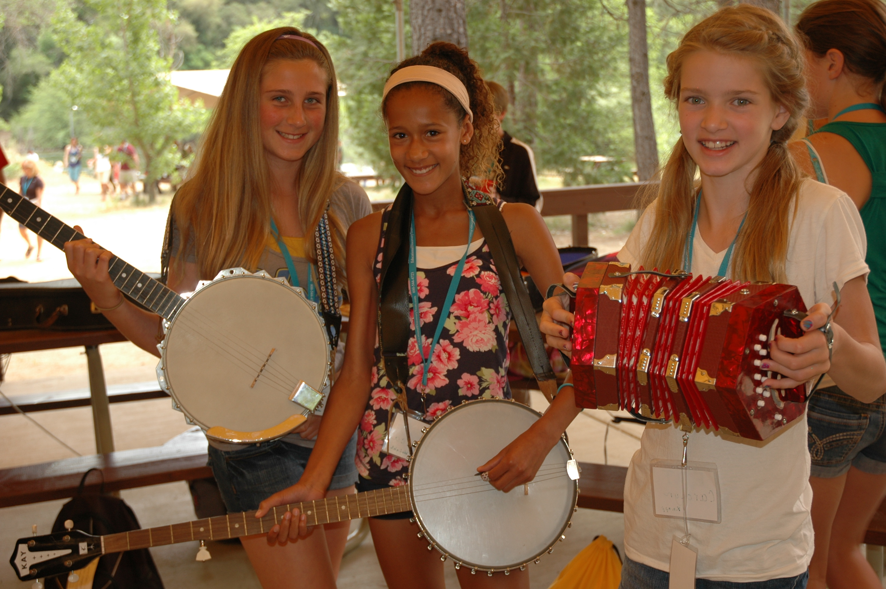 students playing instruments at a gold rush camp during a field trip