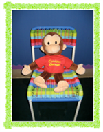 Curious George monkey sitting on chair